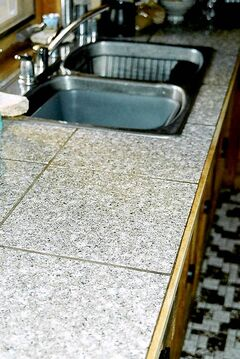 DIY engineered granite tile countertop and backsplash.
