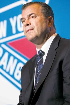 Alain Vigneault takes questions during a news conference after being named the New York Rangers new hockey head coach at Radio City Music Hall, Friday, June 21, 2013, in New York. Vigneault, 52, comes to the Rangers after seven years as coach of the Vancouver Canucks. (AP Photo/John Minchillo)  close cut closecut