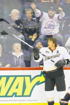 It was all fun and goofing around during the warm-up for Teemu Selanne and Jets fans. Then the puck dropped.