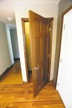 The oak doors automatically turn off the closet light when shut.