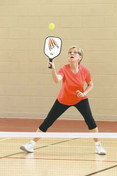 Nina Constable plays Pickleball, a sport that is a little bit badminton, a little bit tennis, at the Sturgeon Heights Community Centre Wednesday morning.