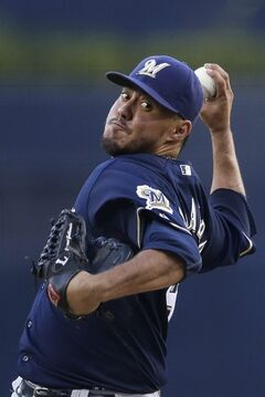 Milwaukee Brewers starting pitcher Yovani Gallardo pitches to a San Diego Padres batter during the first inning in a baseball game Wednesday, Aug. 27, 2014, in San Diego. (AP Photo/Gregory Bull)
