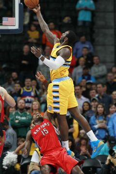 Denver Nuggets forward J.J. Hickson, top, is called for charging as he drives to shoot over Toronto Raptors forward Amir Johnson in the first quarter of an NBA basketball game in Denver, Friday, Jan. 31, 2014. (AP Photo/David Zalubowski)
