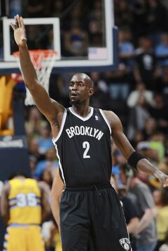 Brooklyn Nets forward Kevin Garnett congratulates a teammate for a basket against the Denver Nuggets in the first quarter of an NBA basketball game in Denver on Thursday, Feb. 27, 2014. (AP Photo/David Zalubowski)