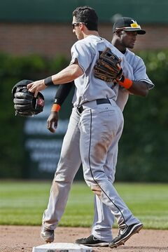 Miami Marlins shortstop Adeiny Hechavarria, rear, and second baseman Ed Lucas celebrate after defeating the Chicago Cubs 4-3 in a baseball game on Sunday, June 8, 2014, in Chicago. (AP Photo/Andrew A. Nelles)