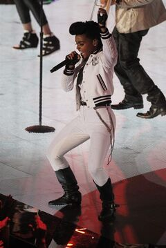 Singer Janelle Mon�e performs during the NBA All Star basketball game, Sunday, Feb. 16, 2014, in New Orleans. (AP Photo/Bill Haber)