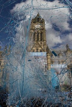 Manchester's town hall is swathed in confetti as the Manchester City team and supporters celebrate at a parade in the city centre the day after their team won the English Premier League title, in Manchester, England, Monday May 12, 2014. (AP Photo/Jon Super)
