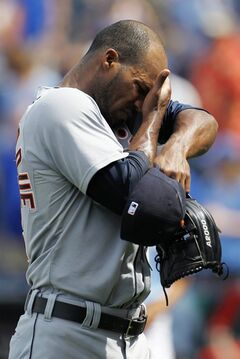 Detroit Tigers relief pitcher Al Alburquerque reacts after being taken out of the game after the Kansas City Royals scored the go-ahead run in the seventh inning of a baseball game at Kauffman Stadium in Kansas City, Mo., Sunday, July 13, 2014. (AP Photo/Colin E. Braley)
