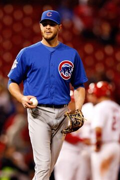 Chicago Cubs relief pitcher Justin Grimm pauses on the mound during the twelfth inning of a baseball game against the St. Louis Cardinals, Tuesday, May 13, 2014, in St. Louis. (AP Photo/Scott Kane)