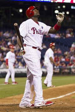 ADVANCE FOR USE SUNDAY, JULY 20 - FILE - In this June 2, 2014, file photo, Philadelphia Phillies' Ryan Howard reacts after striking out in the eighth inning of a baseball game against the New York Mets in Philadelphia. The Phillies are less than three years removed from a dominant run of five straight NL East titles, two pennants and one World Series championship. Despite having the highest payroll in franchise history, they are headed toward another last-place finish. (AP Photo/Chris Szagola, File)