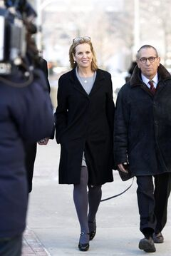 Kerry Kennedy, center, arrives, Monday, Feb. 24, 2014 at a courthouse for her trial in White Plains, NY. In 2012, Kennedy, the ex-wife of New York Gov. Andrew Cuomo, was arrested after her car hit a tractor-trailer on an interstate highway near her home outside New York City. She drove to the next exit, where she failed a sobriety test, police said. Blood tests revealed a small amount of the sleeping drug zolpidem. Kennedy claims she accidentally took a sleeping pill instead of her daily thyroid medication. The trial is expected to last a week. (AP Photo/The Journal News, Ricky Flores)