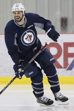 Winnipeg Jets Zach Bogosian is all smiles as he takes part in an informal hockey practice in Winnipeg on Monday.