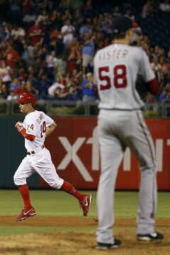 Philadelphia Phillies' Grady Sizemore, left, rounds the bases after hitting a two-run home run off Washington Nationals starting pitcher Doug Fister during the sixth inning of a baseball game, Wednesday, Aug. 27, 2014, in Philadelphia. Philadelphia won 8-4. (AP Photo/Matt Slocum)