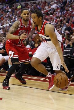 This photo taken April 27, 2014 shows Washington Wizards guard Andre Miller (24) driving past Chicago Bulls guard D.J. Augustin (14) during the second half of Game 4 of an opening-round NBA basketball playoff series in Washington. When the Washington Wizards split up by position for meetings before Game 1 against first-round playoff opponent Chicago, starting guards John Wall and Bradley Beal listened while veteran Miller spoke. After all, twentysomethings Wall and Beal were about to be in the NBA postseason for the first time; the 38-year-old Miller was getting set for his 10th playoff series. All three, though, had something in common. (AP Photo/Alex Brandon)