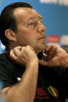 Belgium head coach Marc Wilmots adjusts his translation system headphones during a press conference at the Mineirao Stadium in Belo Horizonte, Brazil, Monday, June 16, 2014. Belgium will play in group H of the Brazil 2014 soccer World Cup. (AP Photo/Bruno Magalhaes)