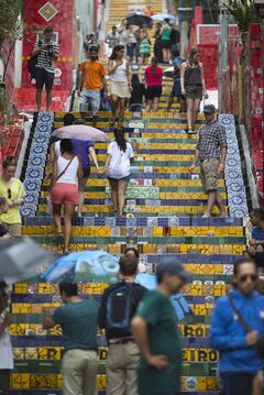 People walk up and down a stairway that was decorated by Chilean artist Jorge Selaron, which he titled the