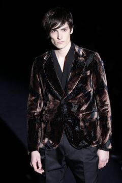 A model wears a creation from the Gucci men's Fall-Winter 2012/2013 collection, part of the Milan Fashion Week, unveiled in Milan, Italy, Monday, Jan.16, 2012. (AP Photo/Luca Bruno)