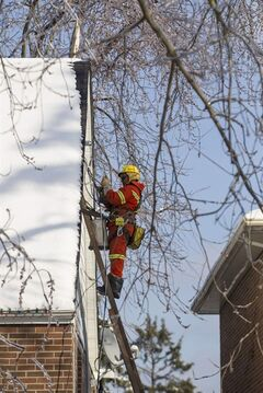 A Toronto Hydro crew member works to restore power to a house in a Scarborough neighbourhood on Friday, December 27, 2013. THE CANADIAN PRESS/Chris Young