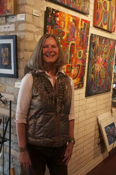 Local artist Genevie Henderson is shown with some of her works at Pulse Gallery at The Forks.