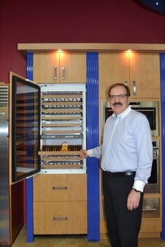 President Harold Kriewald of Stalwart Appliances shows wine cooler with refrigerated drawers below for beer or other beverages.