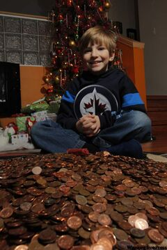 Titus Stewart, 8, raised almost double his weight in pennies.