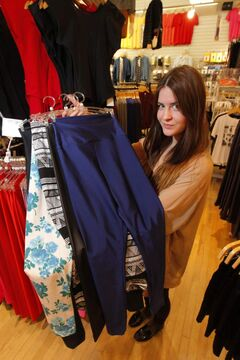 American Apparel's Kirsty Lesperance shows some of the fashionable leggings the store sells.