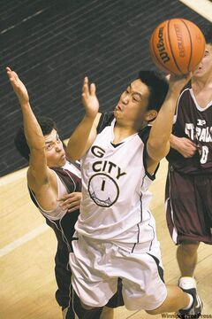 Garden City's Alec Soriano (1) flies to the hoop against St. Paul's defender Quinn Roberts-Stovel.