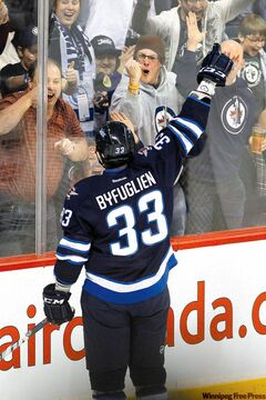 Thank you, thank you. Jets defenceman Dustin Byfuglien plays to the fans after scoring on a clever bank shot in the first period Friday night at the MTS Centre.