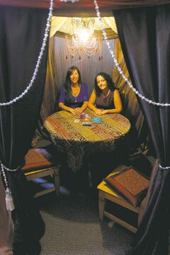 Chantal Roy and Bernice Bisson in one of the silk and satin reading tents in their psychic shop. In addition to communicating with � or busting � ghosts, the shop will sell you teas, candles and other spiritual paraphernalia.