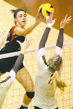 John Woods / Winnipeg Free Press U of W's Ozana Nikolic tries to tap the ball past U of M's Rachel Cockrell during the Duckworth Challenge Tuesday.