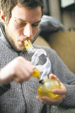 Medical marijuana user Doug Affleck smokes pot he obtained from the Canadian Medical Marijuana Clinic.