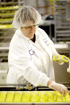 Gail Counterman adjusts a Peeps box as it moves through the manufacturing process at the Just Born factory in Bethlehem, Pa.