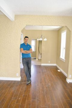 Geoff Milnes in living room of Elmwood house renovated by RentalRatRace.ca. Below: Before photo