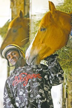 Jockey Christopher Husbands with one of his mounts at Assiniboia Downs.