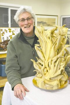 Woodcarver Janet Cruse Thompson creates sculptures from laminated blocks of wood.