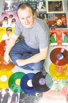 Cavin Borody, inset, has been buying factory-sealed records from stores that went out of business in the 80s and 90s.