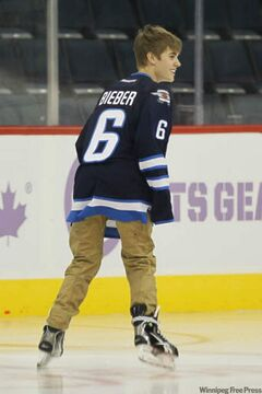Justin Bieber skates at the MTS Centre after the Winnipeg Jets' game against the Carolina Hurricanes today. He and his girlfriend, Selena Gomez, watched the game from an upper-level suite before strapping on their skates and hitting the ice.