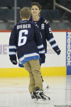 Justin Bieber skates toward girlfriend Selena Gomez at the MTS Centre after the Jets game tonight.