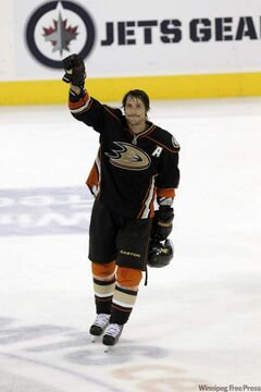 The Anaheim Ducks' Teemu Selanne (8) comes back onto the ice and acknowledges his Winnipeg fans after being selected third star of the game against the Jets at the MTS Centre on Saturday night.