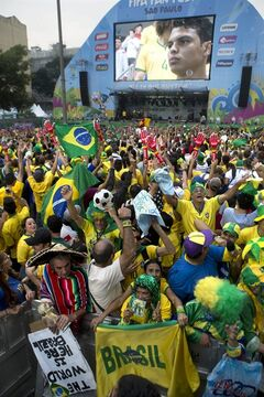 Fans wait for the start of the Mexico vs. Brazil match at the FIFA Fan Fest during the 2014 soccer World Cup in Sao Paulo, Brazil, Tuesday, June 17, 2014. (AP Photo/Dario Lopez-Mills)