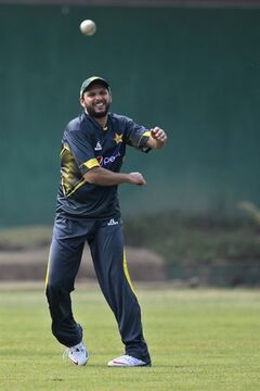 Pakistan's Shahid Afridi, throws a ball during a practice session ahead of the Asia Cup tournament in Dhaka, Bangladesh, Sunday, Feb. 23, 2014. Pakistan plays Sri Lanka in the opening match of the five-nation one day cricket event that begins Tuesday.(AP Photo/A.M. Ahad)