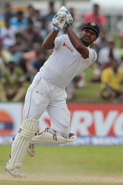 Sri Lankan cricketer Kumar Sangakkara bats during the fourth day of the first test cricket match between Sri Lanka and Pakistan in Galle, Sri Lanka, Saturday, Aug. 9, 2014. (AP Photo/Eranga Jayawardena)