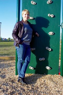 Eaglemere Residents' Association communications co-ordinator Cindy Lange is shown by the new rock wall in John Coulter Park.