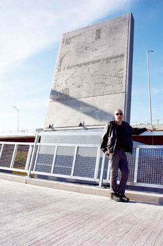 Crescentwood artist Bernie Miller is shown in front of one of the Disraeli Bridge piers that now hold steel panels designed by him. The panels are backlit at night, recreating historical and recent photographs of the bridge.