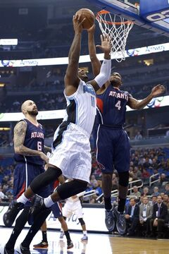 Orlando Magic forward Glen Davis (11) puts up a shot in front of Atlanta Hawks forward Paul Millsap (4) and center Pero Antic (6) during the first half of an NBA basketball game in Orlando, Fla., Wednesday, Jan. 22, 2014. (AP Photo/Phelan M. Ebenhack)