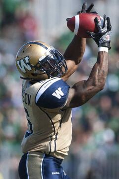 Winnipeg Blue Bombers running back Chad Simpson grabs a pass against the Saskatchewan Roughriders during the first half of Sunday's Labour Day Classic in Regina.