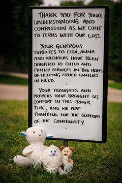 A memorial of stuffed animals and personal notes near Lisa Gibson's family home in Westwood has been replaced with a hand written sign thanking the community for their support.