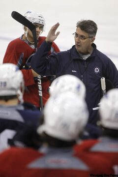 Jets head coach Claude Noel instructs his charges during one of Wednesday's workouts.