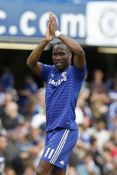 Chelsea's Didier Drogba applauds the fans at the end of their English Premier League soccer match against Leicester City at Stamford Bridge, London, Saturday, Aug. 23, 2014. (AP Photo/Sang Tan)