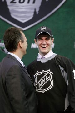 Mark Scheifele, right, is surprised and enthusiastic after being drafted by the Winnipeg Jets in the first round of the National Hockey League entry draft on Friday in St. Paul, Minn.